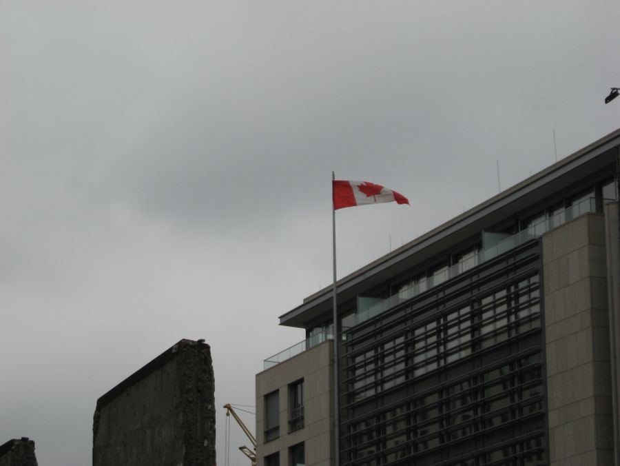 flag of Canada above roofs of Berlin