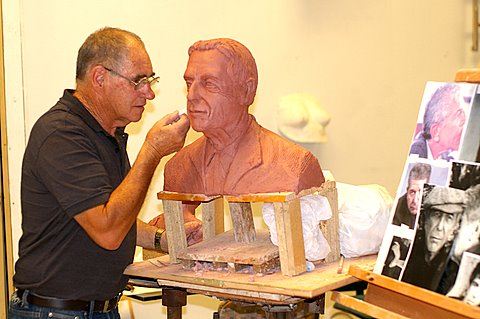 The Sculptor working from Photographs